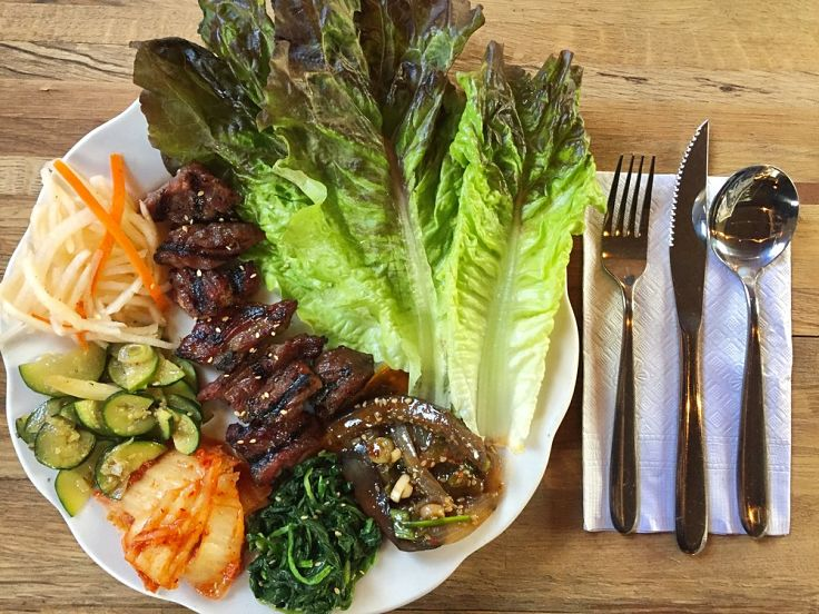 Korean meat dishes served with a variety of fresh vegetables and greens is a very healthy choice