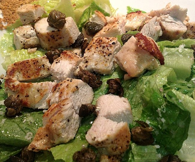 Chicken makes a lovely addition to a Caesar Salad, but the trick is to prepare it so it stays moist and has the lowest possible calories