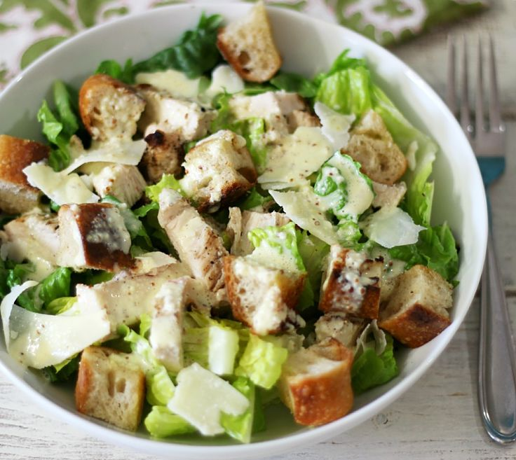 Easy homemade Caesar dressing  drizzled over tender grilled chicken - a delicious snack and party dish